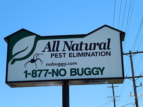 All Natural Pest Elimination Road sign